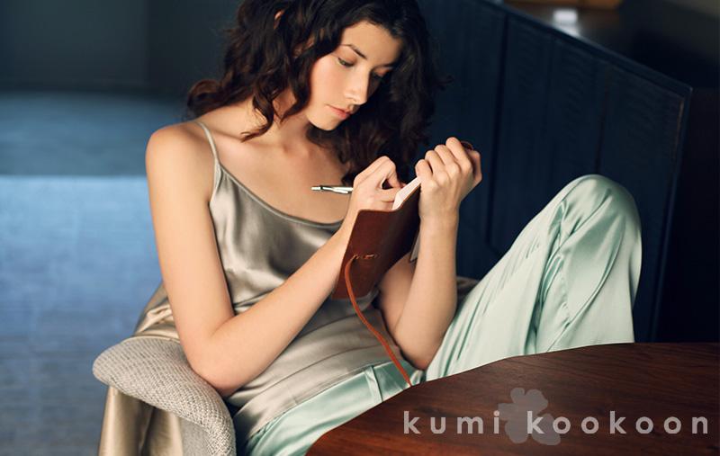kumi kookoon woman sitting image